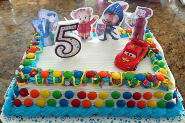 The lazy moms birthday cake: premade ice cream cake, m&ms, printed some of his favorite characters and a toy car. DONE!